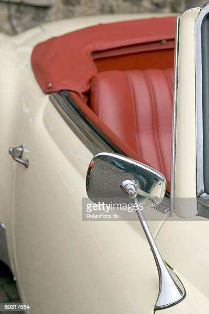 Part of old white vintage convertible with red leather seats