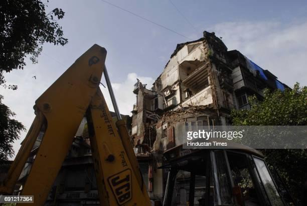 Part of Ramchandra Building collapsed on Sunday night opposite Gokuldas Tejpal Hospital on Lokmanya Tilak Marg near Metro Theatre junction