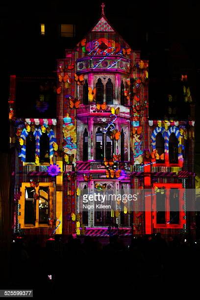 Part of St Paul's Cathedral colourfully illuminated during Melbourne's annual White Night festival Melbourne Australia