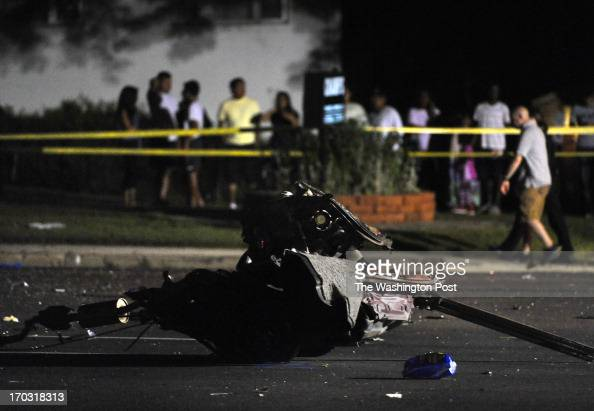 Part of the back end of a car that was torn in half lies in the road on Georgia Ave after a fatal 3vehicle crash that killed a total of 3 people The...
