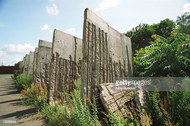 A part of the Berlin Wall stands in Bernauer Strassez July 12 2001 in Berlin Germany The Berlin Wall which was constructed in 1961 by the former...