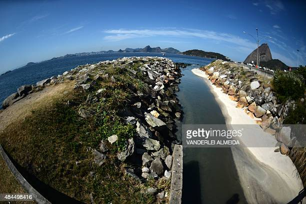 Part of the city's sewage flows on August 19 2015 into the Guanabara Bay in Rio de Janeiro Brazil where the sailing competitions of the Rio 2016...