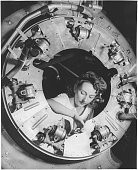 Part of the cowling for one of the motors for a B25 bomber is assembled in the engine department of North American's Inglewood California plant by a...
