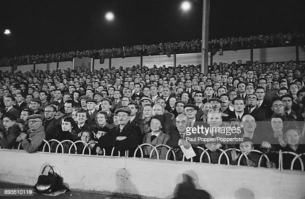 Part of the crowd watching Tottenham Hotspur play a friendly match against the Racing Club de Paris in the first floodlit match at Spurs' White Hart...