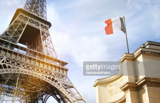Part of the Eiffel Tower in Paris with French flag