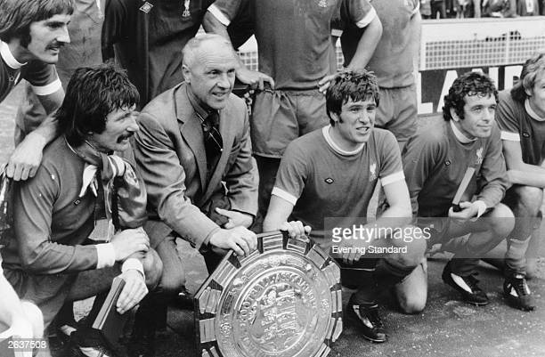 Part of the Liverpool Football team with the Charity Shield after a penalty shoot out victory over Leeds United at Wembley From left to right are...