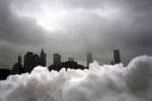 Part of the lower Manhattan skyline seen behind a pile of snow on February 13 2014 in the Brooklyn borough of New York City In what is turning out to...