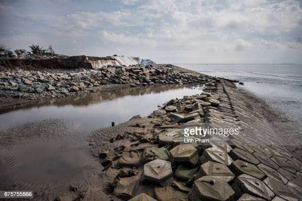 A part of the sea dike was destroyed by high tides on February 2017 photographed on April 29 2017 in Bao Thuan Village Ba Tri District Ben Tre...