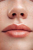 Part of woman's face. Woman's lips and nose. Soft skin.