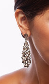 Part of young woman in chandelier earring