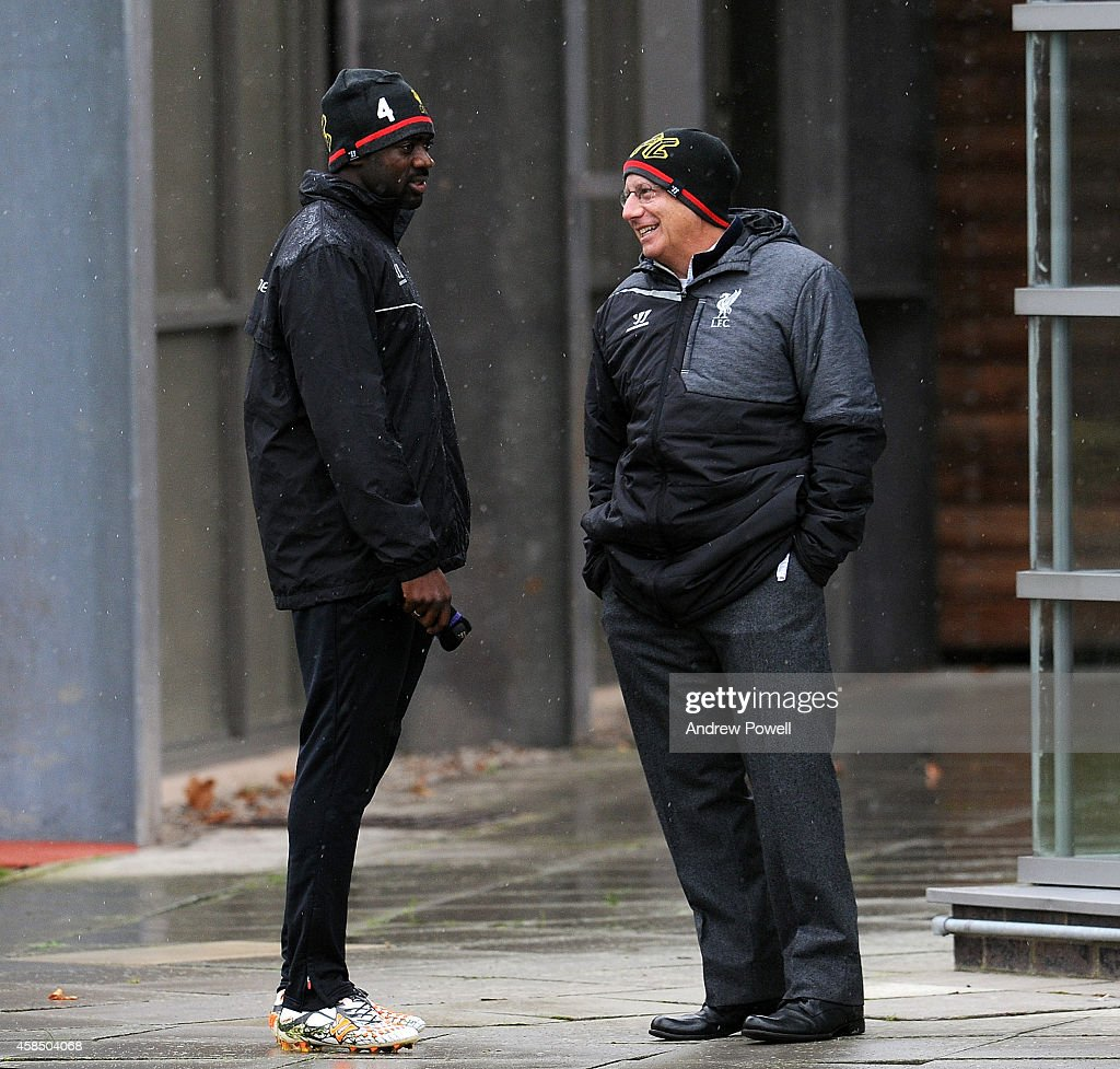 Part owner of Liverpool Tom Werner talks with Kolo Toure during a training session at Melwood Training Ground on November 6, 2014 in Liverpool, England.