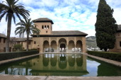 Partal Palace is reflected in a pond in the Alhambra compound in the Spanish city of Granada January 25 2011 The Alhambra and Genralife were declared...