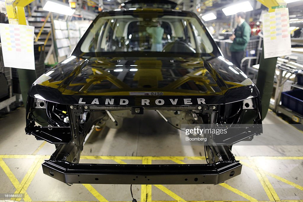 A part-complete Land Rover Freelander 2 SUV automobile, produced by Jaguar Land Rover Plc, a unit of Tata Motors Ltd., travels along the production line at the company's assembly plant in Halewood, U.K., on Wednesday, Feb. 13, 2013. Carmakers from Ford Motor Co. to Audi AG and Jaguar Land Rover Plc are using record amounts of aluminium to replace heavier steel, providing relief to producers of the metal confronting excess supplies and depressed prices. Photographer: Simon Dawson/Bloomberg via Getty Images