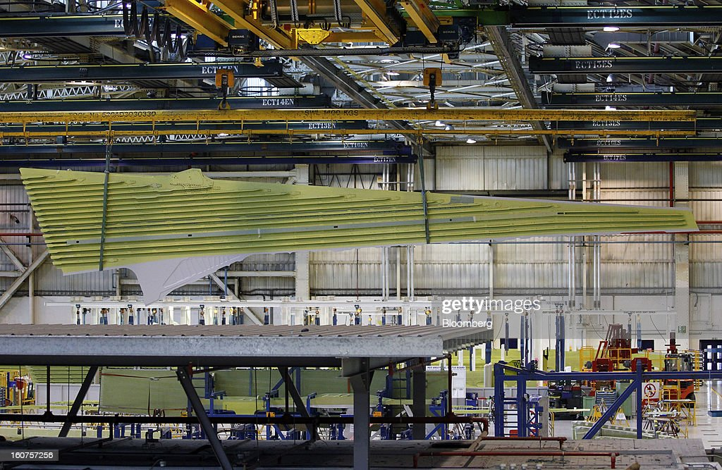 A part-complete section of an A320 wing is maneuvered through the Airbus wing assembly plant in Broughton, U.K., on Monday, Feb. 4, 2013. Airbus SAS won a $9 billion order from Steven Udvar-Hazy's Air Lease Corp. that includes 25 A350 wide-body jets, a competitor to Boeing Co.'s grounded 787 Dreamliner. Photographer: Paul Thomas/Bloomberg via Getty Images
