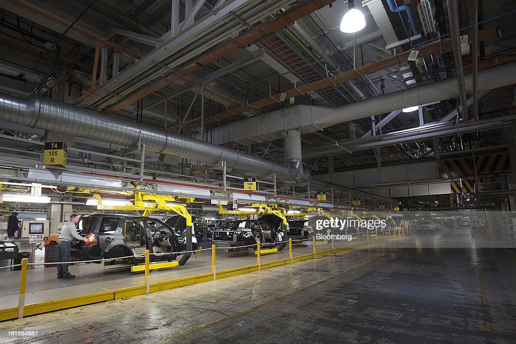 Part-completed Range Rover Evoque and Land Rover Freelander 2 SUV automobiles, produced by Jaguar Land Rover Plc, a unit of Tata Motors Ltd., as they travel along the production line at the company's assembly plant in Halewood, U.K., on Wednesday, Feb. 13, 2013. Carmakers from Ford Motor Co. to Audi AG and Jaguar Land Rover Plc are using record amounts of aluminium to replace heavier steel, providing relief to producers of the metal confronting excess supplies and depressed prices. Photographer: Simon Dawson/Bloomberg via Getty Images