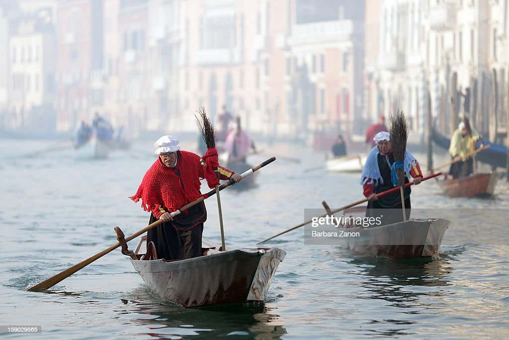 A partecipant dressed as 'Befana' rows on Gran Canal during the traditional Epiphany Boat Race on January 6 2013 in Venice Italy In Italy Epiphany is...