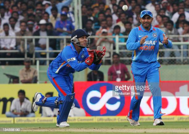 Parthiv Patel of India gets in position to take the catch off West Indies batsman Kieron Pollard as Virendra Sehwag looks on during the 2nd One Day...