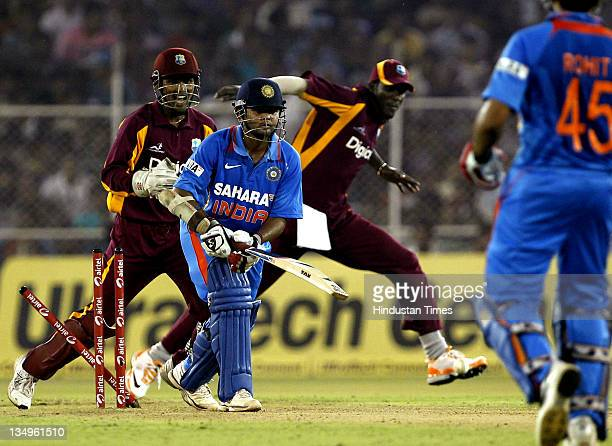 Parthiv Patel of India is bowled by West Indies bowler Marlon Samuels during the 3rd One Day International match between India and West Indies at...