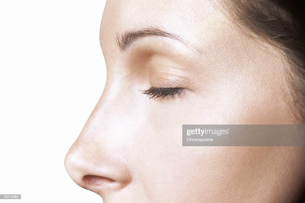 Partial profile of Caucasian female, eyes closed : Stock Photo