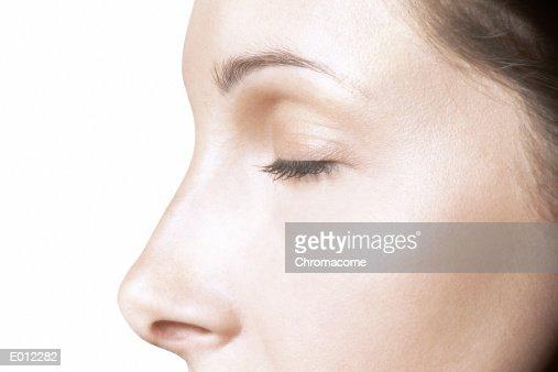 Partial profile of Caucasian female, eyes closed : Bildbanksbilder