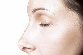 Partial profile of Caucasian female, eyes closed