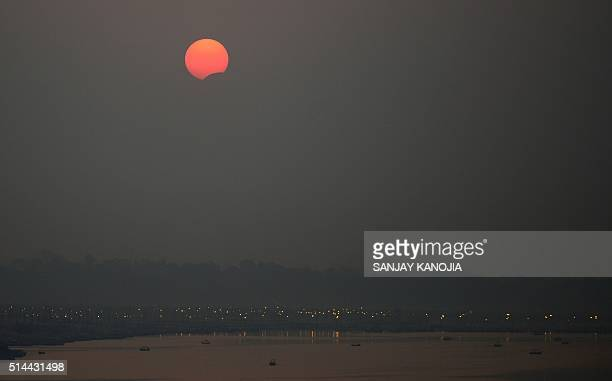 A partial solar eclipse is seen over Sangam the confluence of the Rivers Ganges Yamuna and mythical Saraswati in Allahabad on March 9 2016 / AFP /...