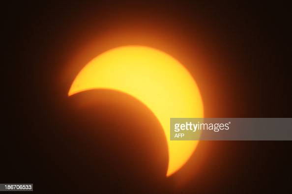 A partial solar eclipse is seen over the Sudanese capital Khartoum on November 3 2013 The rare solar eclipse will sweep across parts of Africa Europe...