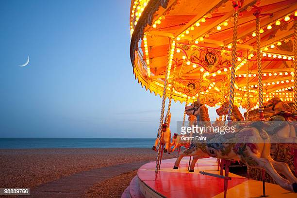 partial view of carousel on beach area