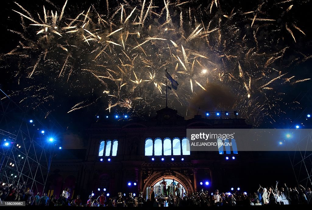 Partial view of Goverment Palace with fireworks at Plaza de Mayo, on December 9, 2012, during a rally on the eve of the Day of Democracy and Human Rights, called by the government to celebrate the 29th anniversary of the return to democracy in Argentina. AFP PHOTO / Alejandro PAGNI
