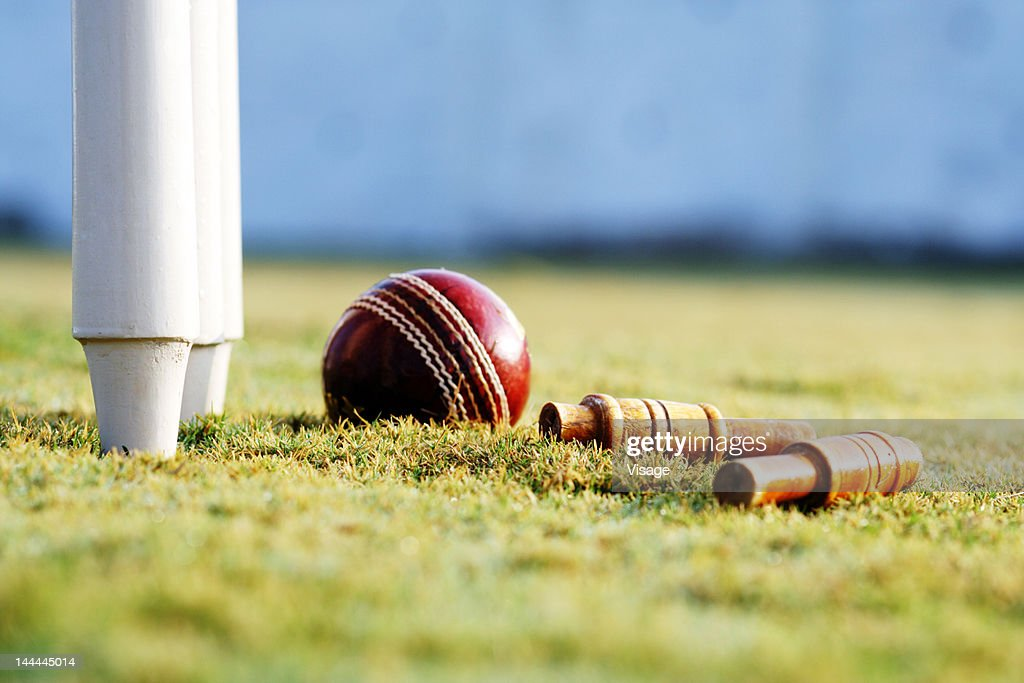 Partial view of the cricket stumps and a ball