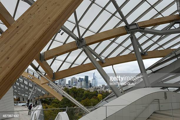 Partial view of the Louis Vuitton Foundation designed by CanadianAmerican architect Frank Gehry backdropped by La Defense business district in Paris...