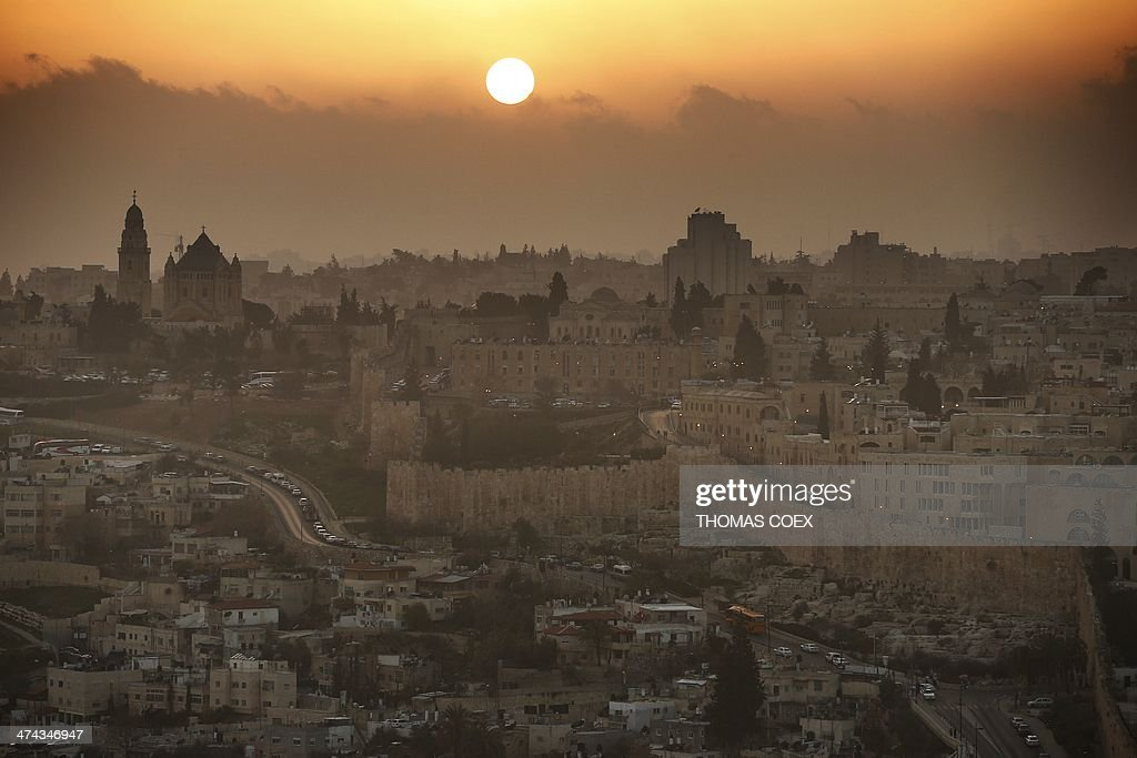 A partial view of the Old City of Jerusalem during sunset, on February 22, 2014. On the left the Christian Abbey of the Dormition. AFP PHOTO/THOMAS COEX