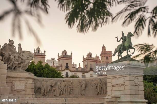 Partial view of the Plaza de EspaÐa in the historic quarter of Càdiz at sunset In the middle part of the image the tops of 2 distinguished 18th...