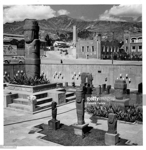 A partial view of The Tiahuanaco Museum in the background you can see the mountains with the clouds hovering over them in La Paz Bolivia 1955