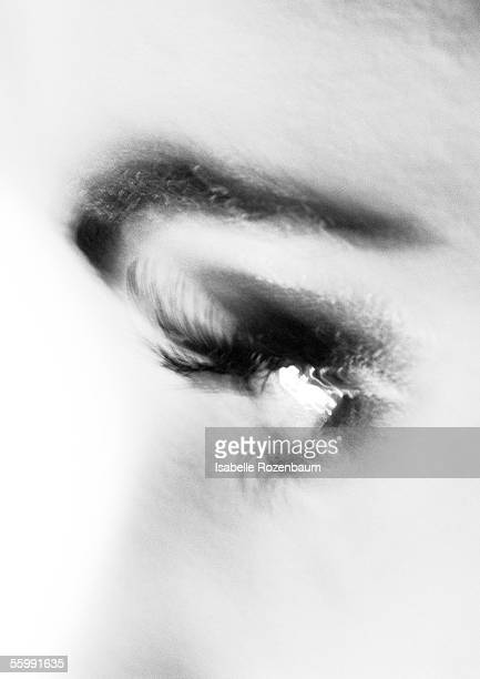 Partial view of woman's face, side view, blurred, black and white.