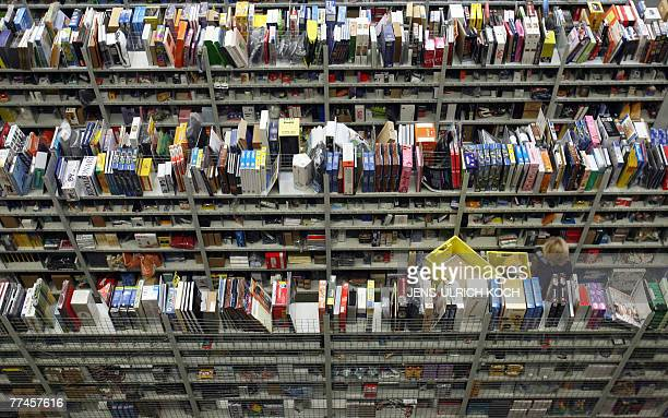 Partial view shows hundreds of books in shelves at the logistic center of US online retail giant Amazoncom in Bad Hersfeld eastern Germany 23 October...