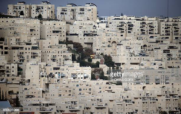 A partial view taken on December 18 2014 shows the east Jerusalem Israeli settlement of Har Homa from the West Bank city of Bethlehem which was...