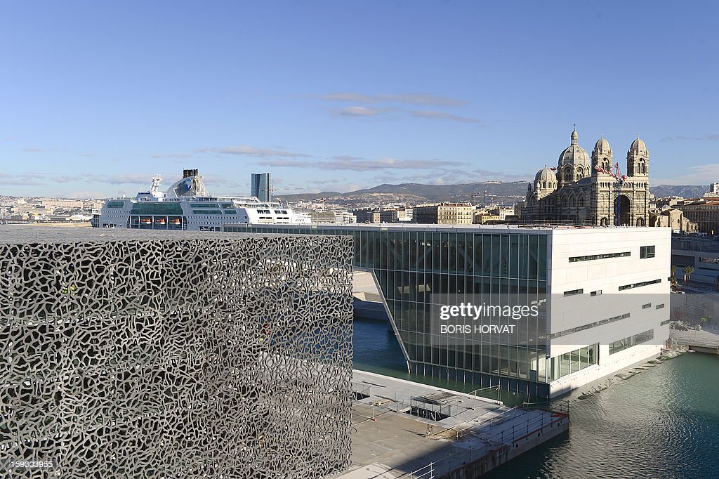 A partial view taken on January 11, 2013 shows the new Museum of Civilizations from Europe and the Mediterranean (MuCEM-LEFT) designed by Italian architect Rudy Ricciotti, and the new 'Centre Regional de la Mediterranee' (Mediterranean Regional Centre-RIGHT) designed by Italian architect Stefano Boeri. Long plagued by a reputation for gang crime and lawlessness, France's port city of Marseille is hoping its year as the 2013 European Capital of Culture will finally give its image a makeover. The gritty Mediterranean city will kick off the festivities on January 12, 2013 with a downtown parade, fireworks and the opening of a slew of exhibitions. At background, the cathedral of Sainte-Marie-majeure also known as La Major.