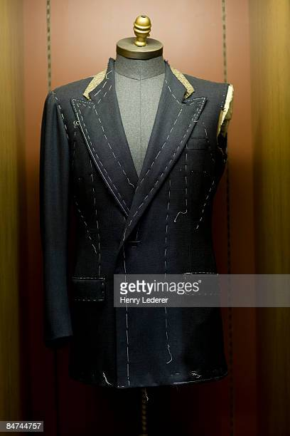 Partially constructed men's suit on mannequin