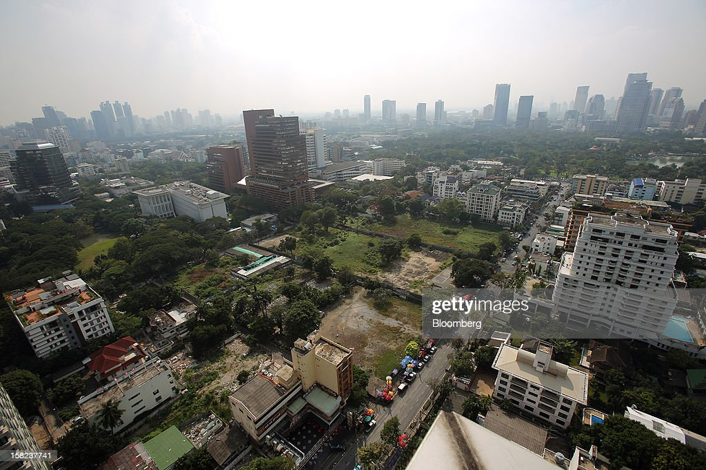 Partially demolished houses, bottom left, stand on a plot of land along Langsuan road in Bangkok, Thailand, on Tuesday, Dec. 11, 2012. The Crown Property Bureau owns about 41,300 rai (66 square kilometers) of land across the country, about a fifth of which is in Bangkok, according to Aviruth Wongbuddhapitak, an adviser to the CPB who sits on the board of two of its subsidiaries. Photographer: Dario Pignatelli/Bloomberg via Getty Images