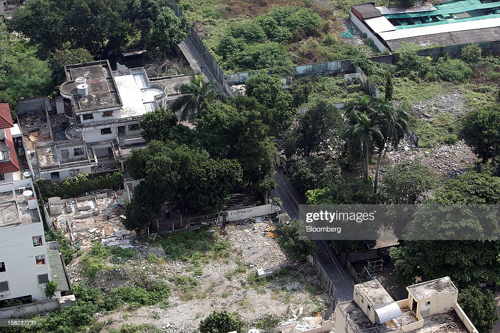 Partially demolished houses stand on a plot of land in a side street off Langsuan road in Bangkok, Thailand, on Tuesday, Dec. 11, 2012. The Crown Property Bureau owns about 41,300 rai (66 square kilometers) of land across the country, about a fifth of which is in Bangkok, according to Aviruth Wongbuddhapitak, an adviser to the CPB who sits on the board of two of its subsidiaries. Photographer: Dario Pignatelli/Bloomberg via Getty Images