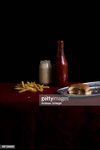 Partially eaten cheeseburger and French Fries, still life