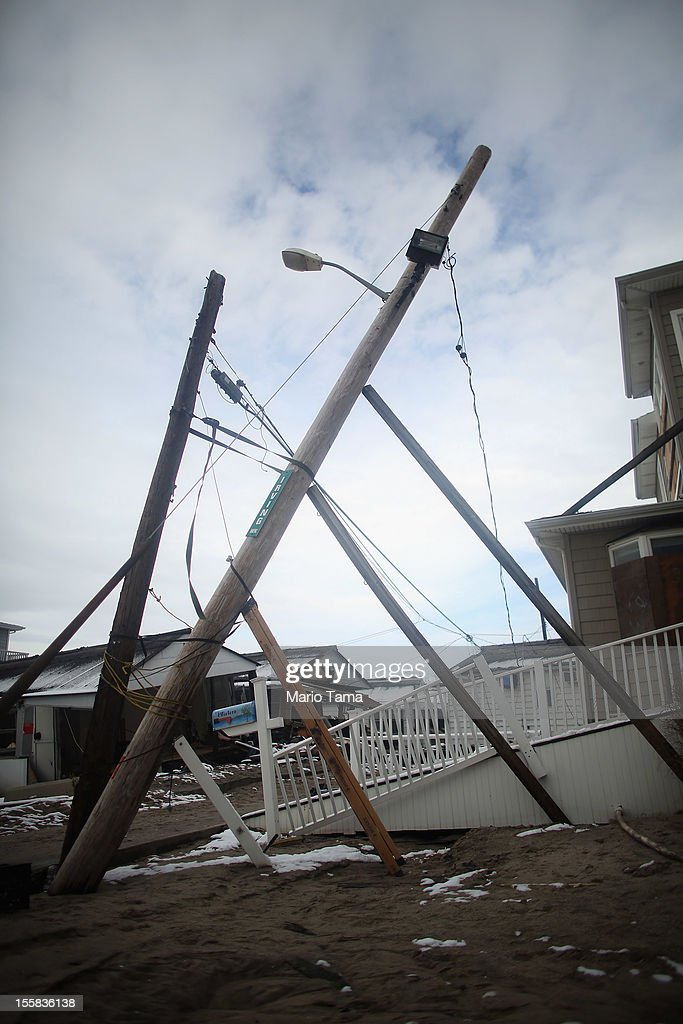 A partially fallen light pole is supported by makeshift pieces of wood in the Breezy Point neighborhood on November 8, 2012 in the Queens borough of New York City. The Breezy Point neighborhood was heavily damaged by Superstorm Sandy.