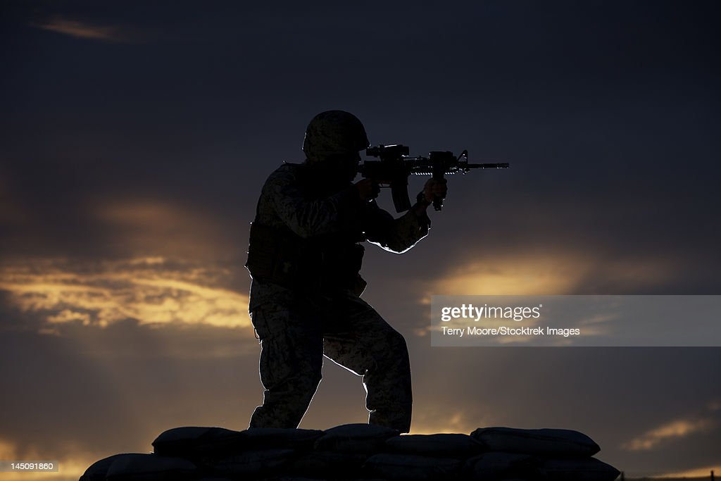 Partially silhouetted U.S. Marine on a bunker in Northern Afghanistan.