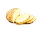 A partially sliced potato on white