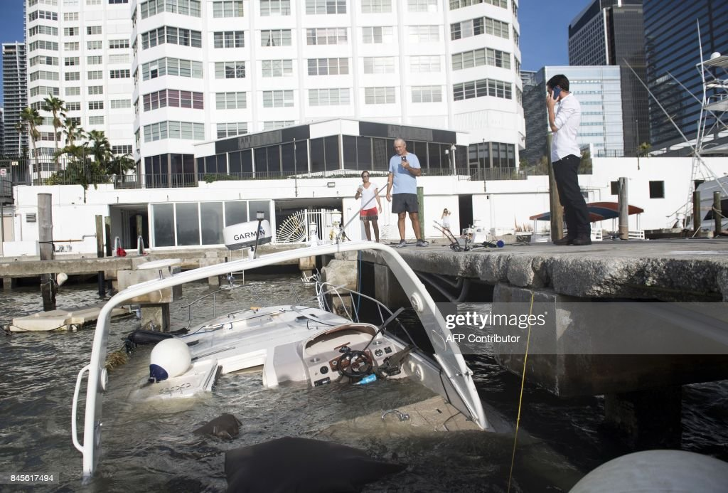 Partially submerged boats caused by Hurricane Irma sit in the water in a marina in downtown Miami, Florida, September 11, 2017. /