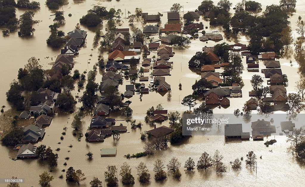 Partially submerged homes are seen in Hurricane Isaac's flood waters on August 31, 2012 in Braithwaite, Louisiana. Louisiana residents continue to cope with the aftermath of Hurricane Isaac with ongoing flooding, destroyed property and many still without electricity.