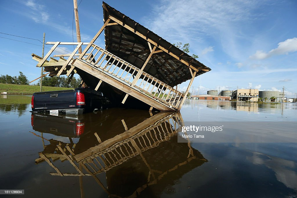 A partially submerged truck and gazebo are seen in Hurricane Isaac's flood waters with a flooded chemical plant in the background on September 1, 2012 in Braithwaite, Louisiana. Louisiana residents continue to cope with the aftermath of Hurricane Isaac with ongoing flooding, destroyed property and many still without electricity.