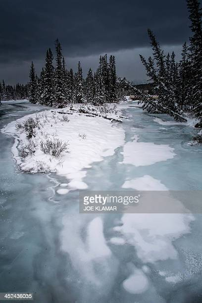 Partialy frozen Bow River makes its way through the Alberta's Banff National Park in Lake Louise the host of men's alpine skiing FIS World Cup in...