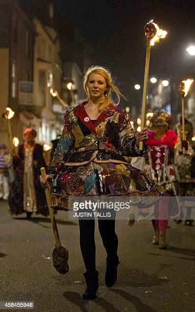 A particiant holds a torch as bonfire societies parade through the streets of Lewes in Sussex on November 5 during the traditional bonfire night...